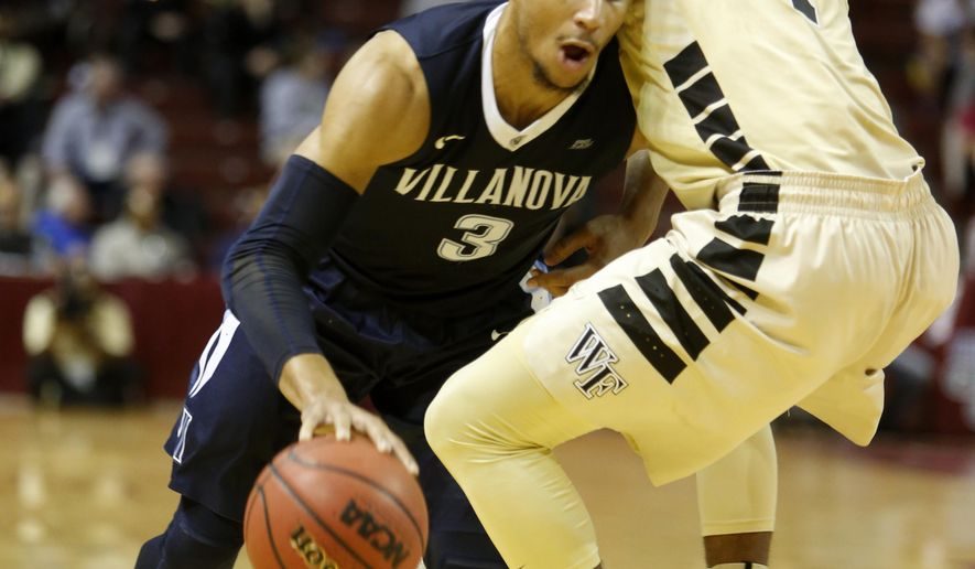 Villanova's Josh Hart (3), left, drives against Wake Forest's Keyshawn Woods during the first half of an NCAA college basketball game at the Charleston Classic at TD Arena, Friday Nov. 18, 2016, in Charleston, S.C. (AP Photo/Mic Smith)