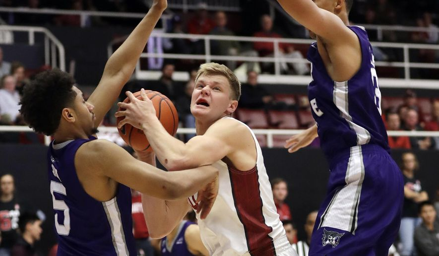 Stanford forward Michael Humphrey, center, is defended by Weber State center Jordan Dallas, right, and guard Cody John (5) during the second half of an NCAA college basketball game Thursday, Nov. 17, 2016, in Stanford, Calif. (AP Photo/Marcio Jose Sanchez)