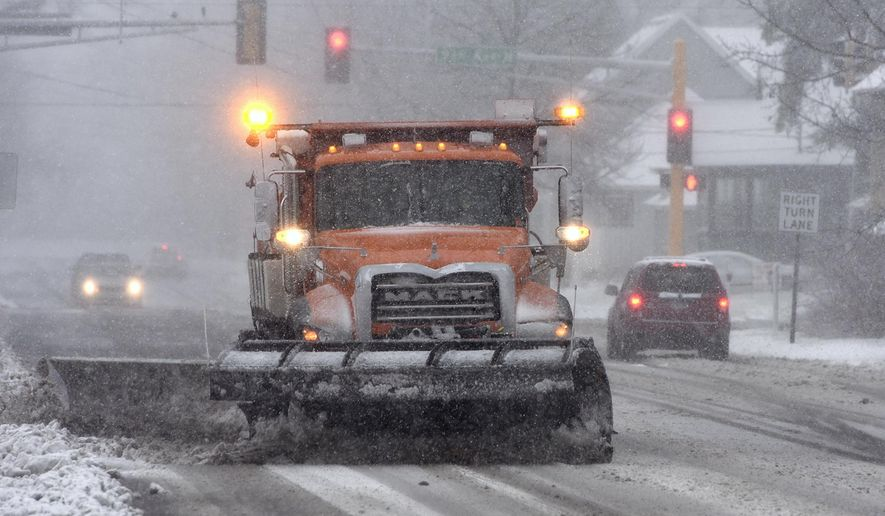 A snow plow clears a section of Veterans Drive Friday, Nov. 18, 2016, in St. Cloud, Minn. Forecasters predict blizzard conditions beginning Friday across central Minnesota where 6 to 12 inches of snow could accumulate by nightfall. Winds of 50 to 60 mph are expected to make travel very difficult. (Dave Schwarz/St. Cloud Times via AP) ** FILE **
