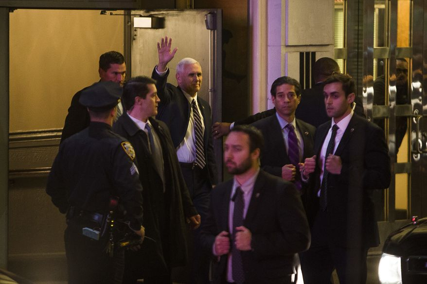 """Vice President-elect Mike Pence, top center, leaves the Richard Rodgers Theatre after a performance of """"Hamilton,"""" in New York, Friday, Nov. 18, 2016. (AP Photo/Andres Kudacki)"""