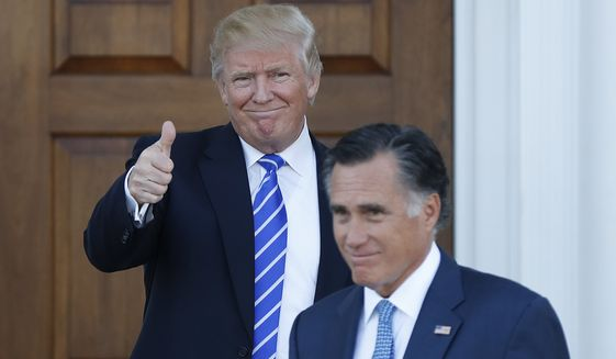 President-elect Donald Trump gives the thumbs-up as Mitt Romney leaves Trump National Golf Club Bedminster in Bedminster, N.J., Saturday, Nov. 19, 2016. (AP Photo/Carolyn Kaster) ** FILE **