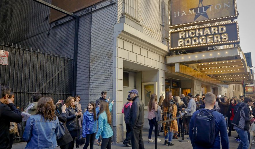 "People line-up to see the Broadway play ""Hamilton,"" Saturday Nov. 19, 2016, in New York. President-elect Donald Trump demanded an apology from the cast of the hit musical a day after an actor lectured Vice President-elect Mike Pence about equality, prompting angry responses from liberals and conservatives. (AP Photo/Bebeto Matthews)"