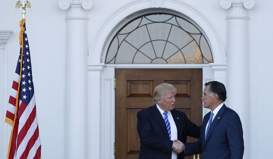 President-elect Donald Trump and Mitt Romney shake hands as Romney leaves Trump National Golf Club Bedminster in Bedminster, N.J., Saturday, Nov. 19, 2016. (AP Photo/Carolyn Kaster)