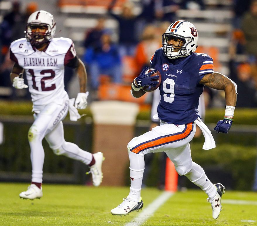 Auburn Running Back Kam Martin (9) Carries The Ball In For