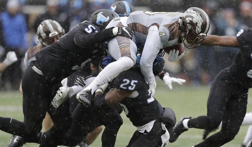 Western Michigan Darius Phillips (4) is tackled on a kickoff return by Buffalo linebacker Jordan Collier (25) and linebacker Nick Ames (57) during the first half of an NCAA college football game, Saturday, Nov. 19, 2016, in Kalamazoo, Mich. (AP Photo/Carlos Osorio)