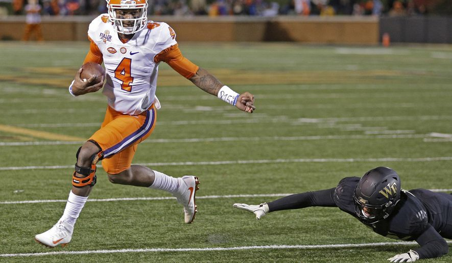 Clemson's Deshaun Watson (4) runs past a Wake Forest player for a touchdown during the first half of an NCAA college football game in Winston-Salem, N.C., Saturday, Nov. 19, 2016. (AP Photo/Chuck Burton)