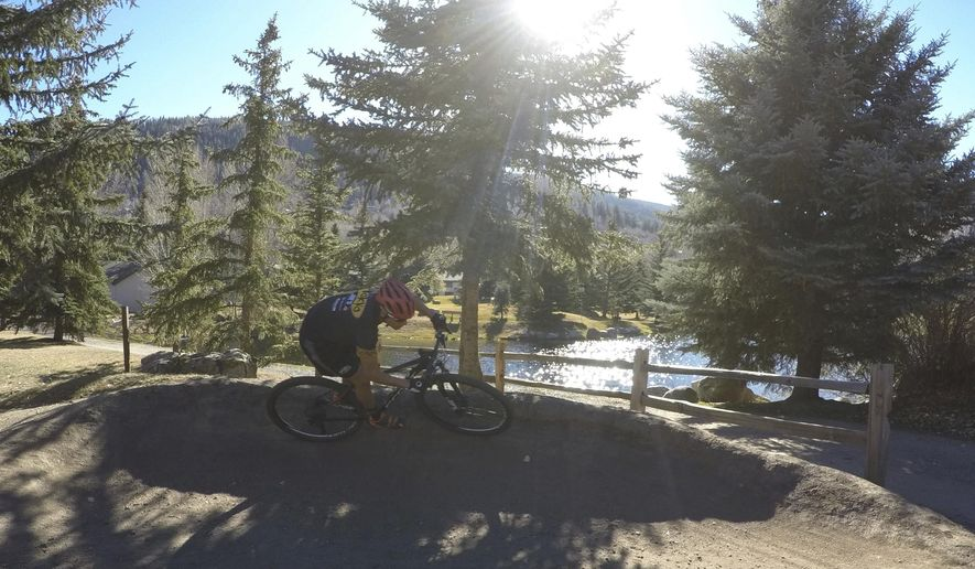 ADVANCE FOR SATURDAY, NOV. 19, 2016 - In this Thursday, Oct. 27, 2016, photo, Cristhian Ravelo of Vail, Colo., takes laps around the pump track in Vail. Ravelo said before becoming a pro cyclist, he had ambitions of becoming a pro skier. On his bike, he says he found his true calling. (John LaConte  /Vail Daily via AP)