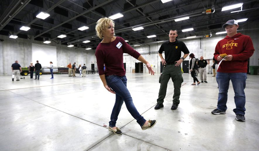 ADVANCE FOR USE SATURDAY, NOV. 19, 2016, AND THEREAFTER- In this Nov. 8, 2016, photo, Volunteer Megan McKenna takes a field sobriety test as multiple law enforcement agencies participated in field sobriety evaluation training at the Dubuque County Emergency Responder Training Facility in Dubuque, Iowa. (Mike Burley/Telegraph Herald via AP)
