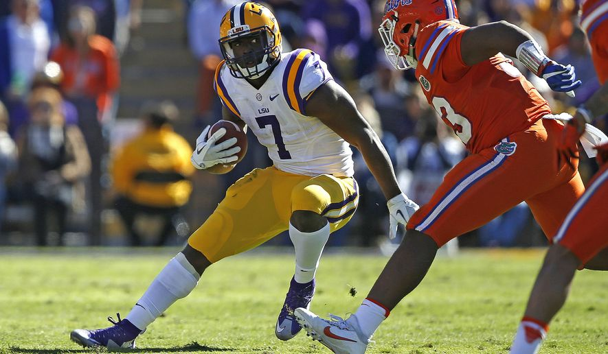 LSU running back Leonard Fournette (7) carries in the first half an NCAA college football game against Florida in Baton Rouge, La., Saturday, Nov. 19, 2016. (AP Photo/Gerald Herbert)