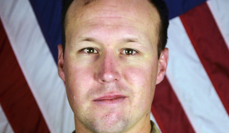 This undated file photo provided by the Fort Hood, Texas Press Center shows U.S. Army Sgt. John W. Perry of Stockton, Calif. Stewart Perry, the father of a soldier recently killed in Afghanistan says he felt disrespected and hurt by passengers who booed him and his family when they were on a flight that was running late to meet his son's remains and passengers were asked to remain seated so they could deplane first. Perry's son, 30-year-old Sgt. John Perry, of Stockton, California, died of injuries inflicted by an improvised explosive device attack Nov. 12, 2016, inside Bagram Airfield. (Department of Defense via AP, File) **FILE**