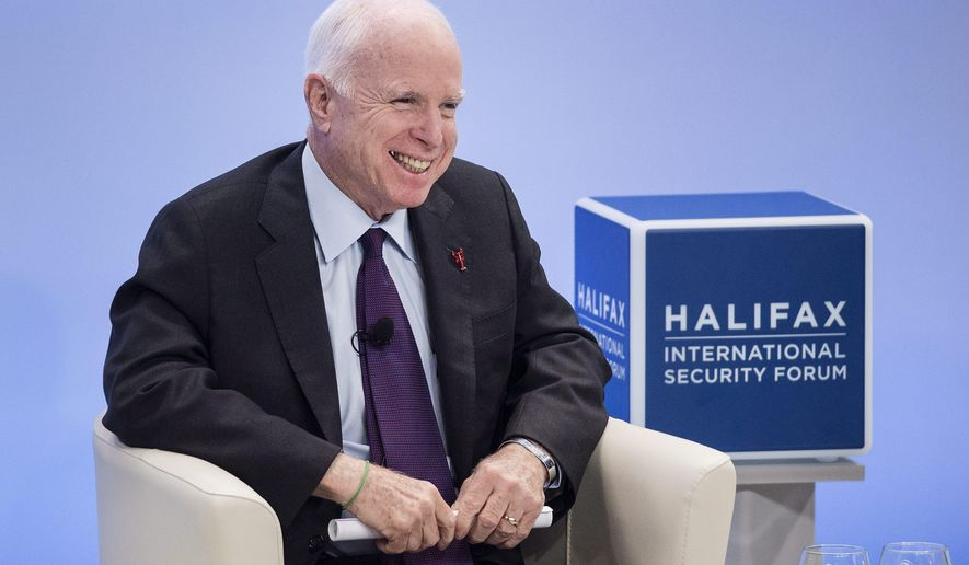 Sen. John McCain, R-Ariz., laughs while speaking at the Halifax International Security Forum in Halifax on Saturday, Nov.19, 2016. (Darren Calabrese/The Canadian Press via AP)