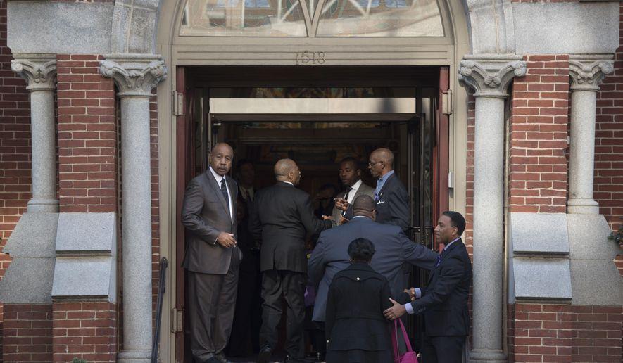 Attendees arrive at Metropolitan A.M.E. Church for the memorial service for journalist Gwen Ifill in Washington, Saturday, Nov. 19, 2016. (AP Photo/Sait Serkan Gurbuz)