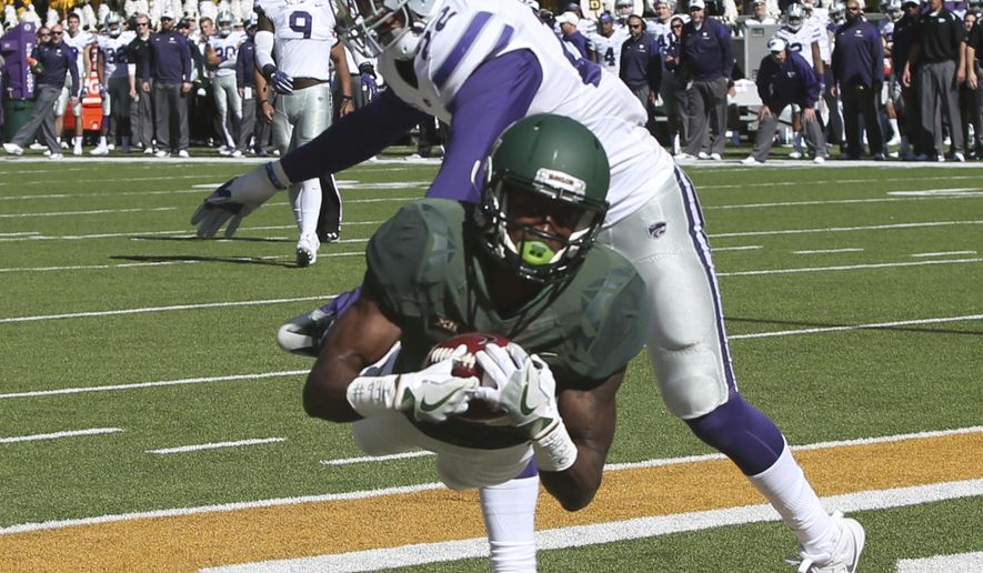 Baylor wide receiver Chris Platt scores on Kansas State defensive back Dante Barnett, right, in the first half of a NCAA college football game, Saturday, Nov. 19, 2016, in Waco, Texas. (Michael Bancale/Waco Tribune Herald, via AP)