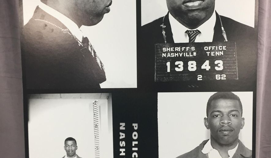 This combination of photographs provided by the Nashville Police Department shows recently discovered never-before-published photos of civil rights icon John Lewis' arrest while leading an effort to desegregate the city's lunch counters in the early 1960's in Nashville. Mayor Megan Barry surprised Lewis with the records Saturday, Nov. 19, 2016, while he was on stage at the Nashville Public Library to receive a literary award. (Nashville Police Department via AP)