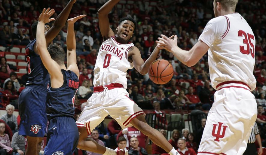 Indiana guard Curtis Jones (0) looses the ball after being fouled by Liberty guard Xzavier Barmore, left, in the second half of an NCAA college basketball game in Bloomington, Ind., Saturday, Nov. 19, 2016. Indiana won 87-48. (AP Photo/AJ Mast)