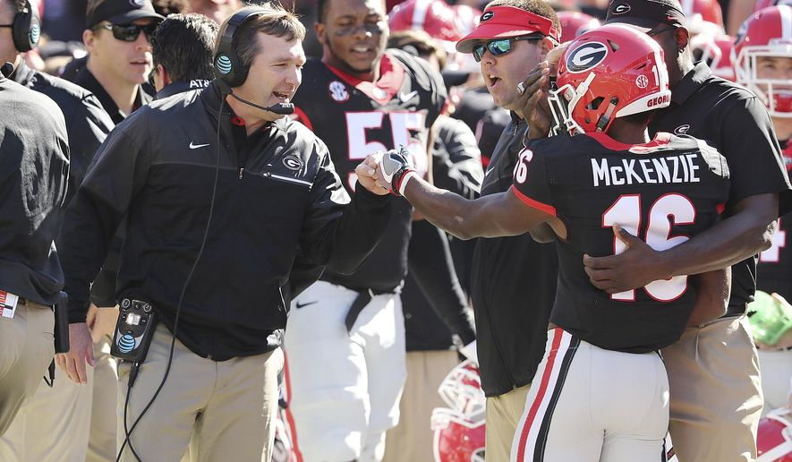 Georgia wide receiver Isaiah McKenzie gets a fist bump from head coach Kirby Smart after returning a punt against Louisiana-LaFayette for a touchdown during the first quarter in an NCAA college football game on Saturday, Nov. 19, 2016, in Athens. (Curtis Compton/Atlanta Journal-Constitution via AP)
