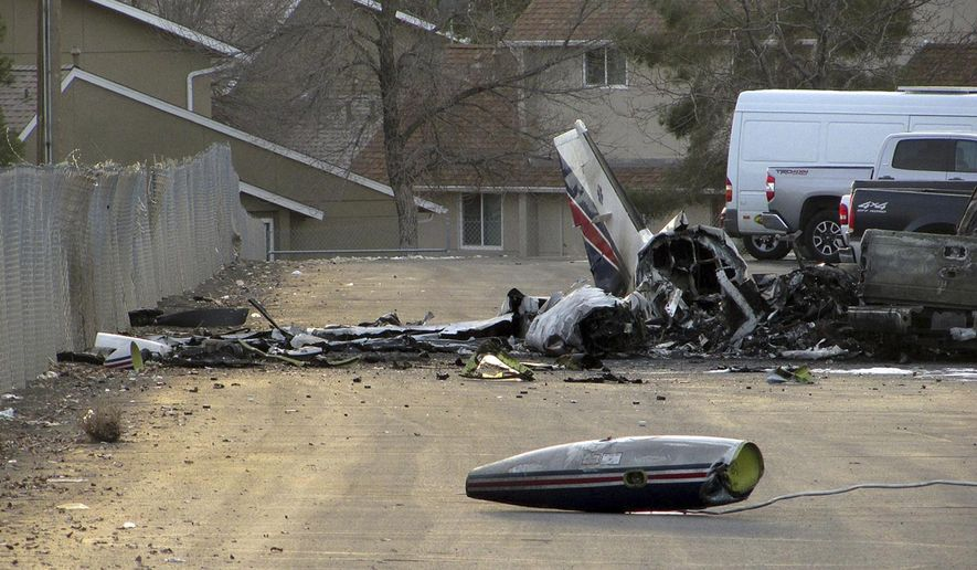 The wreckage of an American Medflight plane sits in the Barrick Gold Corp. parking lot  in Elko, Nev., Saturday, Nov. 19, 2016.  The Federal Aviation Administration and the National Transportation safety board will investigate the fiery crash in northern Nevada in which all four people aboard the air-ambulance flight were reported killed.    (Jeffry Mullins/The Daily Free Press via AP)