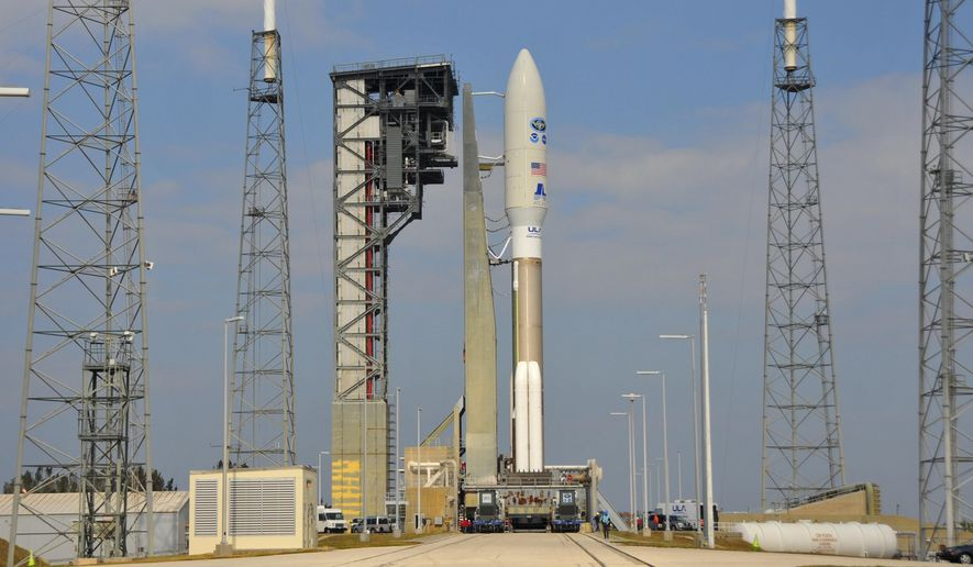 A NOAA GOES-R weather satellite aboard a United Launch Alliance Atlas V rocket, is rolled out to Launch Complex 41 at Cape Canaveral Air Force Station in Florida on Friday, Nov. 18, 2016. The rocket is scheduled to launch at 5:42 p.m., on Saturday. (Malcolm Denemark/Florida Today via AP)