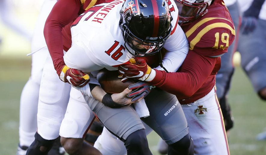 Texas Tech quarterback Nic Shimonek (16) is sacked by Iowa State defenders Jomal Wiltz (17) and JaQuan Bailey (19) during the first half of an NCAA college football game, Saturday, Nov. 19, 2016, in Ames, Iowa. (AP Photo/Charlie Neibergall)