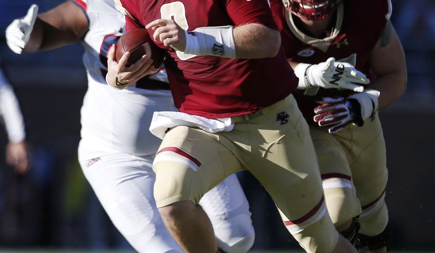 Boston College quarterback Patrick Towles (8) carries the ball during the first half of an NCAA college football game against Connecticut in Boston, Saturday, Nov. 19, 2016. (AP Photo/Michael Dwyer)