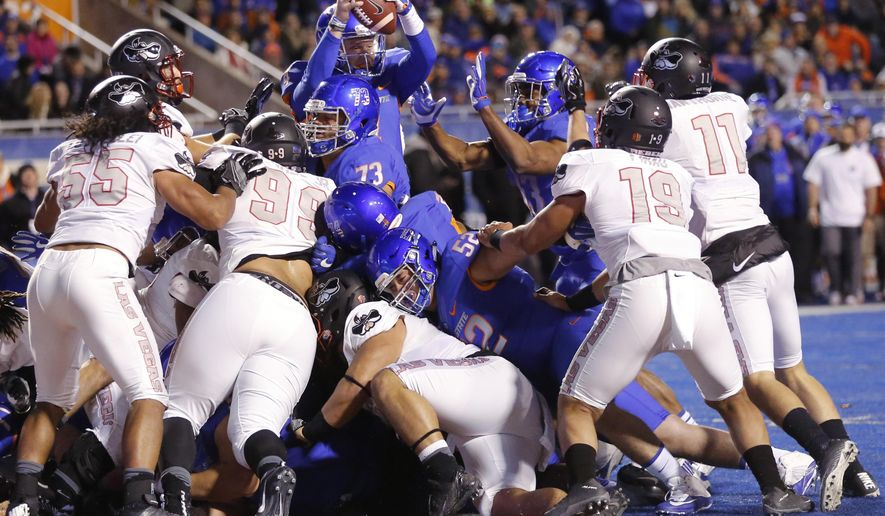Boise State quarterback Brett Rypien makes it into the end zone from inside the 1-yard line for a touchdown during the first half of an NCAA college football game against UNLV in Boise, Idaho, Friday, Nov. 18, 2016. (AP Photo/Otto Kitsinger)