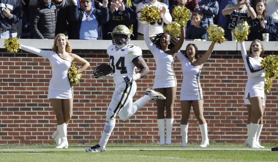 Georgia Tech's Marcus Marshall runs the ball for a touchdown in the second quarter of an NCAA college football game against Virginia in Atlanta, Saturday, Nov. 19, 2016. (AP Photo/David Goldman)