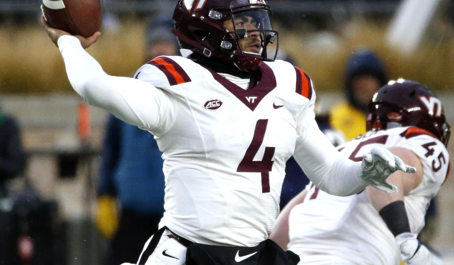 Virginia Tech quarterback Jerod Evans looks to pass during the first half of an NCAA college football game against Notre Dame in South Bend, Ind., Saturday, Nov. 19, 2016. (AP Photo/Nam Y. Huh)
