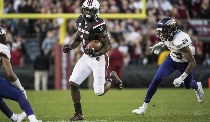 South Carolina wide receiver Deebo Samuel (1) picks up yardage against Western Carolina defensive back Marvin Tillman (29) during the first half of an NCAA college football game Saturday, Nov. 19, 2016, in Columbia, S.C. (AP Photo/Sean Rayford)
