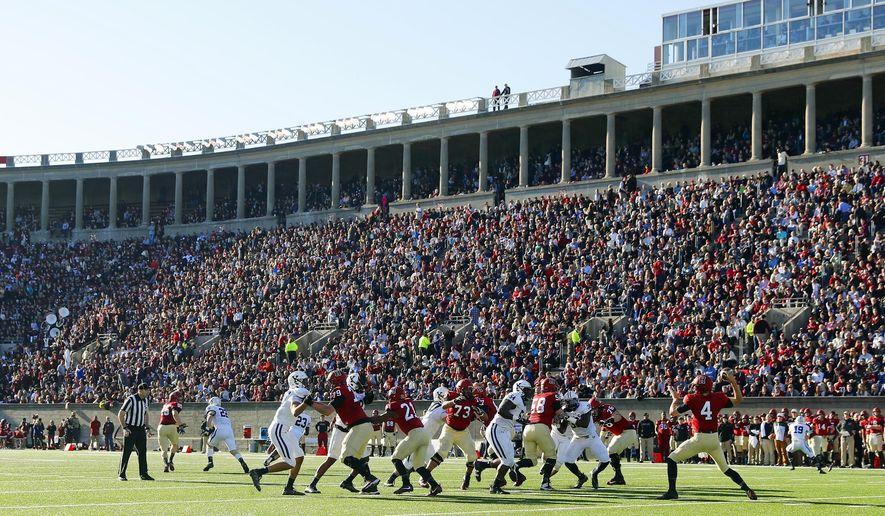 Harvard and Yale play in an NCAA football game at Harvard Stadium in Cambridge, Mass. Saturday, Nov. 19, 2016. (AP Photo/Winslow Townson)