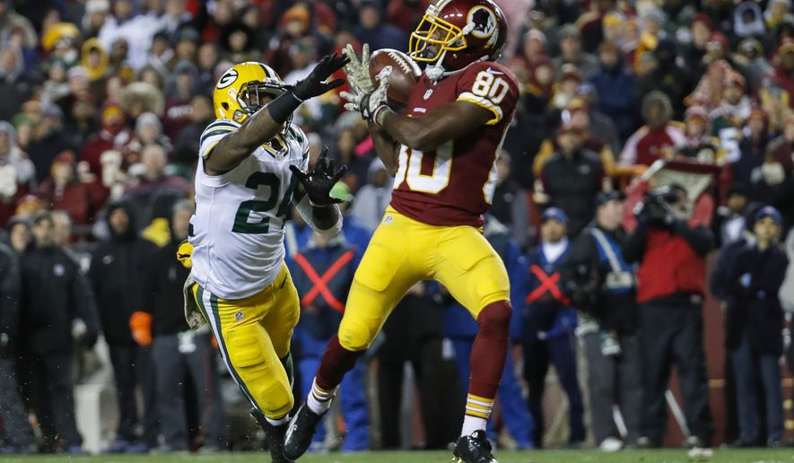 Washington Redskins wide receiver Jamison Crowder (80) pulls in a touchdown pass un pressure from Green Bay Packers cornerback Quinten Rollins (24) during the second half of an NFL football game in Landover, Md., Sunday, Nov. 20, 2016. (AP Photo/Alex Brandon)
