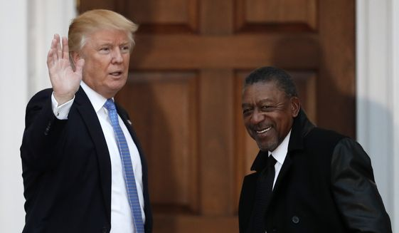 President-elect Donald Trump, left, stands with BET founder Robert Johnson at the Trump National Golf Club Bedminster clubhouse, Sunday, Nov. 20, 2016, in Bedminster, N.J.. (AP Photo/Carolyn Kaster) ** FILE **