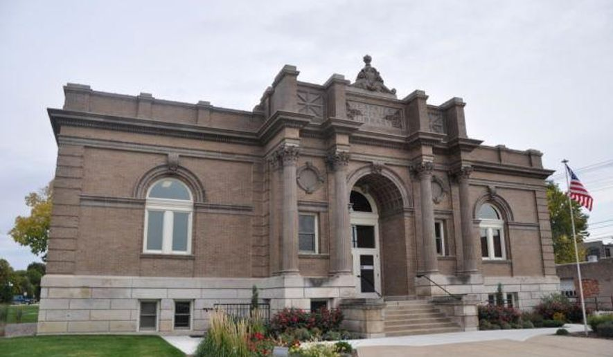 This 2013 photo shows the Carnegie, in Beatrice, Neb. It's been more than a century since the Carnegie on North Fifth Street was constructed, but some in the community still have deep connections to the men and women who are responsible for its development and completion. The former home of Beatrice's Public Library now houses the Chamber of Commerce, Gage County Tourism and NGage economic development group. Constructed in 1903 after the city received a grant from Andrew Carnegie, the Carnegie was purposed to hold the city's first public library. (Scott Kperski  /Beatrice Daily Sun via AP)