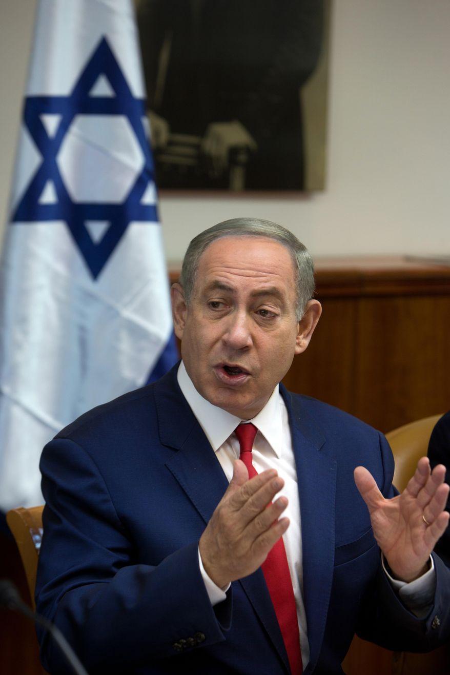 Israeli Prime Minister Benjamin Netanyahu gestures as he chairs the weekly cabinet meeting in Jerusalem on Sunday, Nov. 20, 2016. (Menahem Kahana, Pool via AFP)