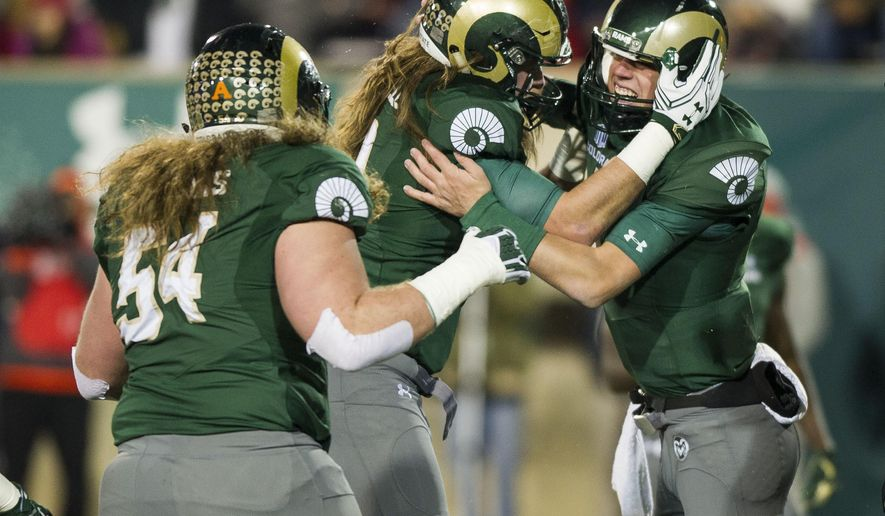 Colorado State Rams quarterback Nick Stevens (7) celebrates scoring a touchdown with tight end Dalton Fackrell (30) in the first quarter of an NCAA college football game against New Mexico, Saturday, Nov. 19, 2016, in Fort Collins, Colo. (Daniel Brenner/The Coloradoan via AP)