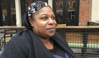 Samaria Rice, whose 12-year-old son Tamir Rice was fatally shot by a white Cleveland police officer on Nov. 22, 2014, sits while having her photograph taken during a Wednesday, Nov. 16, 2016, interview in Cleveland. Samaria Rice told The Associated Press on Wednesday, Nov. 16, 2016, that she's trying to find a path forward for her family, and working to create a foundation in Tamir's name using part of a $6 million settlement with the city. (AP Photo/Mark Gillispie)