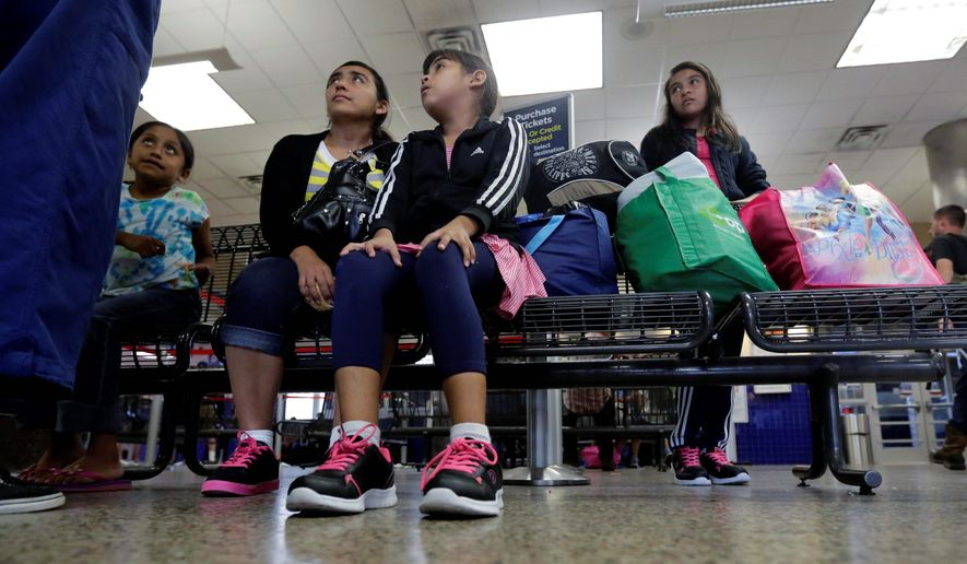 Central Americans start to forgo smugglers and enter the U.S. illegally as families, using children as deportation shields. (Associated Press)
