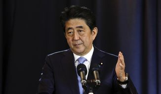 Japanese Prime Minister Shinzo Abe talks during a press conference in Buenos Aires, Argentina, Monday, Nov. 21, 2016. Abe met with Argentina's president on Monday as part of an official visit to boost trade ties between the two countries. (AP Photo/Luciano Matteazzi) ** FILE **