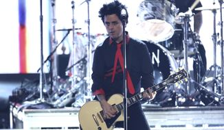 """""""No Trump, no KKK, no fascist USA,"""" Green Day frontman Billie Joe Armstrong chanted, repeating a frequent refrain by liberals and leftists about Mr. Trump. (Associated Press)"""