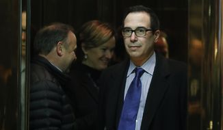 Steven Mnuchin, national finance chairman of President-elect Donald Trump's campaign, boards an elevator as he arrives at Trump Tower, Monday, Nov. 21, 2016 in New York, to meet with President-elect Donald Trump. (AP Photo/Carolyn Kaster)