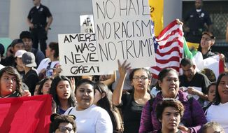 In this Nov. 14, 2016 file photo, students from several high schools rally on the steps of City Hall after walking out of classes to protest the election of Donald Trump as president in downtown Los Angeles. Thousands of high school students have taken to the streets in cities across the country since Trump's election to protest his proposed crackdown on illegal immigration and his vulgar comments about women. It's an unusual show of political involvement on the part of young people who can't even vote yet. And experts say it can lead to increased activism when they are adults. (AP Photo/Reed Saxon, File)