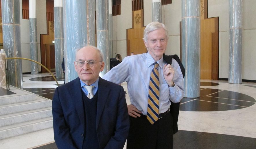 Canadian lawyers David Matas, left, and David Kilgour pose for a photograph at Australia's Parliament House in Canberra, Australia Monday, Nov. 21, 2016. The pair came to Australia's Parliament House on Monday to persuade lawmakers to pass a motion urging China to immediately end the practice of what they say is organ harvesting from prisoners of conscience. (AP Photo/Rod McGuirk)