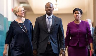 D.C. Mayor Muriel Bowser (right) nominated Antwan Wilson to become the next chancellor of D.C. Public Schools on Tuesday. They are joined by D.C. Deputy Mayor for Education Jennifer Niles. (Associated Press)