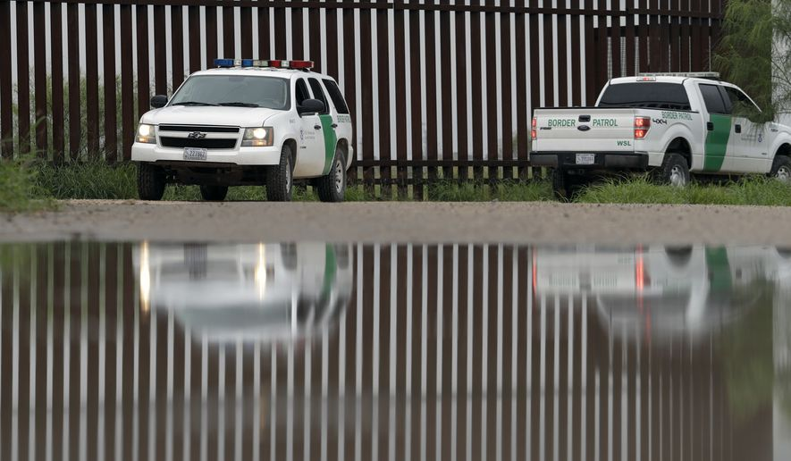 In this Sunday, Nov. 13, 2016, photo, a U.S. Customs and Border Patrol agents pass a section of border wall in Hidalgo, Texas. The idea of a concrete wall spanning the entire 1,954-mile southwest frontier collides head-on with multiple realities, like a looping Rio Grande, fierce local resistance, and cost. (AP Photo/Eric Gay)