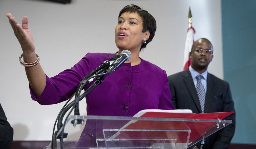 Washington Mayor Muriel Bowser, left, speaks at a news conference at Easter High School in Washington, Tuesday, Nov. 22, 2016, to announce Antwan Wilson, right, the new Washington Schools Chancellor. (AP Photo/Andrew Harnik) ** FILE **