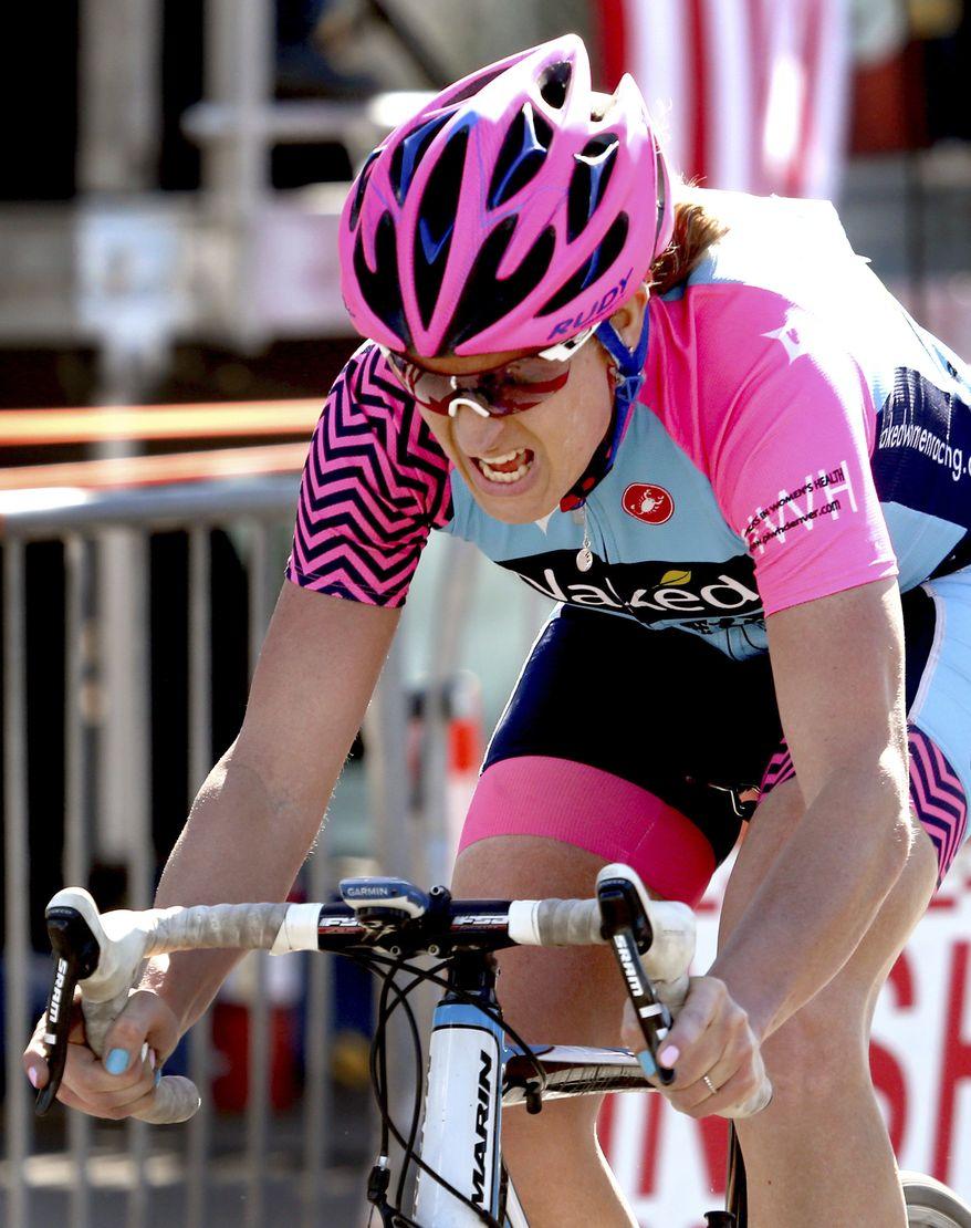 Jillian Bearden, the women's division top finisher, crosses the finish line in the 34th El Tour de Tucson cycling race, Saturday, Nov. 19, 2016, Tucson, Ariz. (Kelly Presnell/Arizona Daily Star via AP)