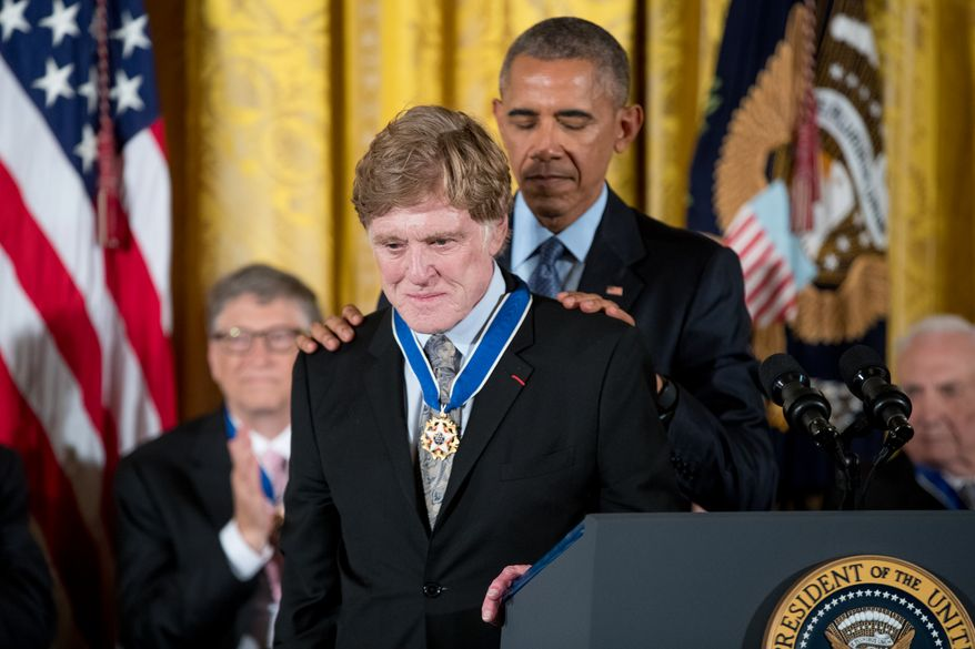 President Barack Obama presents the Presidential Medal of Freedom to actor Robert Redford during a ceremony in the East Room of the White House, Tuesday, Nov. 22, 2016, in Washington. (AP Photo/Andrew Harnik)