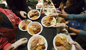 Plates of hot turkey dinners with all the trimmings are taken by volunteers to serve over 1,000 residents during the 40th annual Friends of the Poor Thanksgiving Community Dinner at the Scranton Cultural Center, Tuesday, Nov. 22, 2016, in downtown Scranton, Pa. (Butch Comegys /The Times & Tribune via AP) ** FILE **