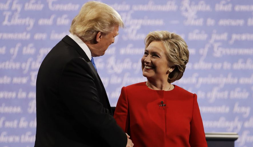 """I don't want to hurt the Clintons, I really don't,"" President-elect Donald Trump said. ""[Hillary Clinton] went through a lot and suffered greatly in many different ways."" (Associated Press)"