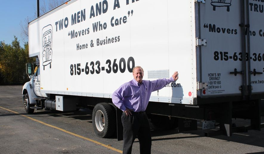 """ADVANCE FOR USE SATURDAY, NOV. 26, 2016 AND THEREAFTER - In this Nov.  4, 2016 photo, Bob Christensen stands outside his office at Two Men and a Truck in Loves Park, Ill. Because he's a veteran, Christensen hires fellow vets to work at his three locations in Illinois and Iowa. Veterans have the strength and skills to handle the workload at Two Men and a Truck, he said. """"They show up on time. They're eager to work. And most important, they've learned team building,"""" Christensen said. (Kristen Zambo/The Journal-Standard, via AP)"""