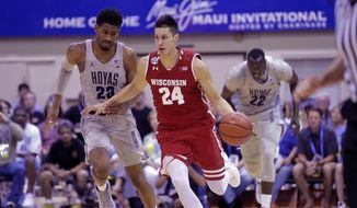 Georgetown's Rodney Pryor (23) and Akoy Agau (22) pursue Wisconsin guard Bronson Koenig (24) in the second half during an NCAA college basketball game in the Maui Invitational Tuesday, Nov. 22, 2016, in Lahaina, Hawaii. (AP Photo/Rick Bowmer)